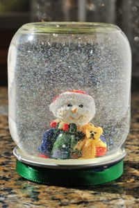 We didn't have much when I was little. My mom could do anything with stuff around the house. Leftover babyfood jars, plastic 'snow' or sparkles, mini figurines, water and glue created my love of snowglobes to this day. Simple, yet memorable. Make sure you bring your kids in on the creative design. They'll remember it.. :)
