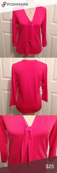 """Banana Republic, Pink V Neckline with Tie, Blouse Banana Republic, Gorgeous Soft Fuchsia Pink Pullover Blouse. Has a V Neckline with a Double Fabric Tie. Option to Wear as Shown in Pic or Tied in a Bow. The Fabulous 92% Micro Modal & 8% Spandex Fabric is what Makes this Blouse Stunning! Made with Stretch, with a Lose & Comfortable Flattering Slimming Fit. Length is 24"""" Long, Chest 36"""" to 38"""" & Shoulder 15.5"""". In Excellent Flawless Condition! Banana Republic Tops Blouses"""