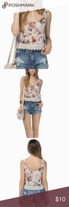 Tobi Marigold Top in Ivory New with tag! Sort of cropped so goes will with high waisted shorts. Light material and a little see through. Very cute floral pattern with a cute lace fringe. Perfect for festivals! Coachella anybody?! 100% polyester Tobi Tops Crop Tops