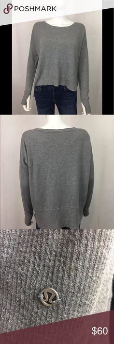Lululemon Gray sweater size 4 metal logo Soooooo cute! Casual hi-low gray Lululemon sweater. Throw it on with yoga pants or with jeans and boots! *measurements coming soon 1017-156-P lululemon athletica Sweaters Crew & Scoop Necks