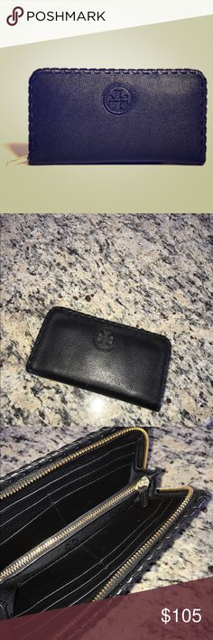 Tory Burch Marion One Zip Wallet This wallet is in great condition with a one zip soft leather style. Tonal whip stitch design with cutout logo in front of wallet. Gold hardware Tory Burch Bags Wallets