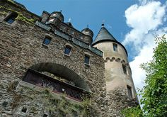 """Reichsburg Cochem - Some original Romanesque and Gothic elements, including the four-story Octagonal Tower and the Hexenturm (""""witches tower""""), were incorporated into new castle. The Witches Tower gets its name from the time when legend claims it was used to try women for witchcraft – by throwing them out of an upper window."""