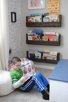 Pallet Shelves in this Boy Bedroom {MAKEOVER} - Gray walls, picture frame wallpaper, pops of orange & blue. The perfect space for a young boy to teen.  You won't w...