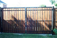 Estate Fence Wood & Iron Privacy Panel Fence Pictures | Fortress Fence