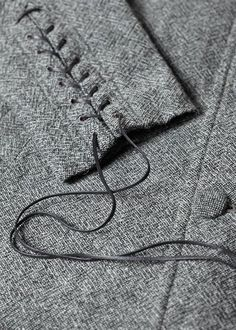 Tweed coat with laced up sleeve detail; sewing inspiration; close up fashion detail // Robert Geller                                                                                                                                                     More