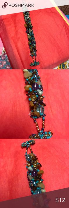 Beautiful beaded handmade bracelet This is so pretty with gemstone chips, and beads in purple and turquoise shades with cream and amber accents! Just gorgeous and so comfortable to wear! Two adjustable positions. Excellent condition! Jewelry Bracelets