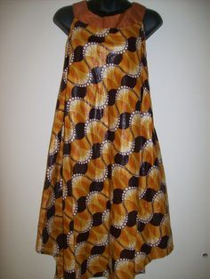 Plus Size baby doll dress in African print. $29.99, via Etsy.