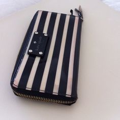 ~Kate Spade Clutch/Wallet~ This pre-loved wallet has many compartments and in great condition! A classic! Black and Tan stripes with material lining. Check out my closet for several other Kate Spade items! kate spade Bags