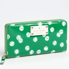 "Kate Spade Wallet Tennis balls bounce across on a glossy coated canvas zip around continental wallet with 12 credit card slots, 2 billfolds, zipper change pocket & exterior slide pocket.   4.0""h x 7.6""w x 0.8""d. kate spade Bags Wallets"