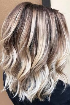 Icy Blonde Balayage with Warm Tones