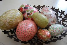 Plastic eggs covered with paper.