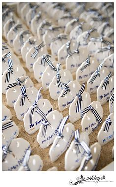 Nautical wedding? Try keepsake sand dollar coasters as escort cards tucked in a container of sand. http://favorcouture.theaspenshops.com/by-the-shore-sand-dollar-coaster.html