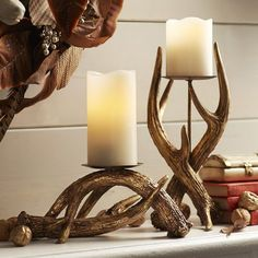 Crafted to resemble a pair of intertwining antlers, our exclusive rustic pillar stands make a strong base for your favorite candles. Fitted with an iron pillar plate, they're finished with a resinous golden glaze for a touch of glam.