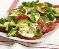 Avocado, Tomato and Mozzarella Salad Recipe. If you like traditional Italian insalata caprese, try this similar red, white and green tricolore salad with fresh mozzarella cheese, fresh basil, and the addition of avocados for extra flavor.