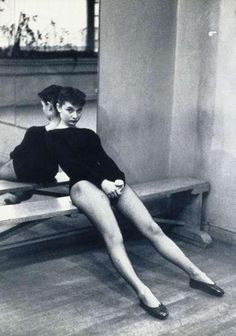 Ms. Audrey Hepburn takes a break during dance class, 1950s.