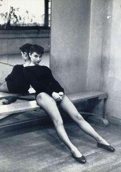 Audrey Hepburn takes a break during dance class, 1950s