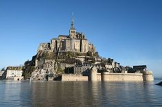 "A picture taken on February 22, 2015 shows the Mont-Saint-Michel surrounded by the sea during high tide. France kicked off nearly a month of exceptionally large spring tides on February 21, as tourists flocked to coastal areas to witness spectacularly high water levels ahead of the so-called ""tide of the century"" March 21.  Photo: Damien Meyer, AFP / Getty Images"