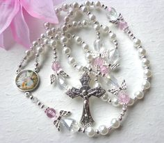 Beautiful Keepsake Rosary and made with Love...makes a lovely gift. The Avé Maria beads are 6mm white pearled glass beads and separated by high