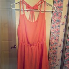 Cute pink / salmon sundress with bow This adorable dress has double straps on either side that meet in the back with a bow. It's in great condition. Mine Dresses Midi