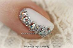 Shimmery nail design that could complement Snowflake outfit