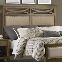 Highlighted by bold nailhead trim and lattice details, this rubberwood headboard enriches your guest room or master suite with rustic appeal.