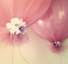 Inflate Ballon... Cover With Tulle... Tie Flower Around Bottom! Beautiful and Easy!!