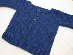 Demne is a first size baby cardigan worked from cuff to cuff in one piece.