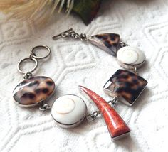 Unique Sterling Silver Tortoise Shell Puka Shell and Sponge Coral Bracelet by bijoullery on Etsy