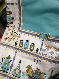 Great turquoise vintage 1950s tablecloth. Visit my blog http://cdiannezweig.blogspot.com/    Spotted at the Stratford Antiques Center, Stratford, CT