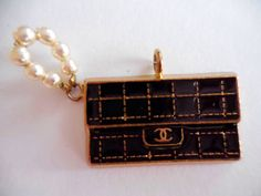 Authentic Chanel gold plated metal charm with small CC logo by JijiVintage on Etsy https://www.etsy.com/listing/265926958/authentic-chanel-gold-plated-metal-charm
