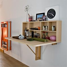 When not in use the table top folds down to hide the top support and take up no space. Alternatively, with a bit of DIY savvy you could design the top to lift up and serve as a door for the integral shelf unit. - See more at: http://www.home-dzine.co.za/diy-1/diy-foldup-dining-table.html#sthash.xIXGi4a0.dpuf