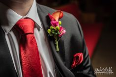 Pink lily boutonniere with red tie
