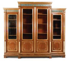 A Russian neoclassical style brass-mounted and verre églomisé-inset mahogany bookcase height 95 3/4 in.; width 101 1/2 in.; depth 23 1/2 in. 243.5 cm; 257.5 cm; 60 cm