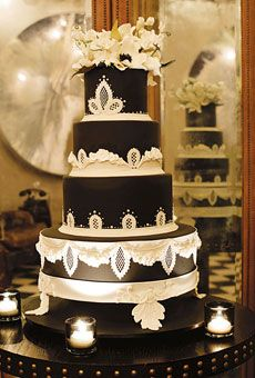 Delectable dark chocolate fondant wedding cake with delicate ivory sugarcraft by artist extraordinaire Ron Ben-Israel, New York, New York....