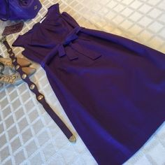 """Calvin Klein purple dress ☮ Like new (worn once) deep purple Calvin Klein dress with self tie belt and pleating detail around the round collar neck comes to just below the knee. Sleeveless and kick pleat in the center back.  Mid zip back.  Length 38""""   Bust 16"""" waist 13.5"""".  Sz 2. This is a very nice piece and can be dressed up or down and year round depending on accessories and layering.  (I have it shown w/ a vintage Posh sweater, my large Coach bag, beige Michael Antonio booties, and faux…"""