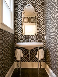 "Love the sink. ""Powder rooms are usually where I really go all out, break all the rules and use materials that might look 'over the top' in larger spaces,' says interior designer Melissa Miranda. Dark colors or bold patterns, like this graphic lattice wallpaper, add dimension and a bit of fun."" Design by Jennifer Jones"