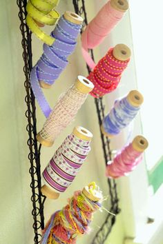 What a clever way to store not only ribbon, but spools and cones of thread.