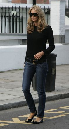 Modern appeal, thanks to slim, low-slung denim, mixed perfectly with a black crew-neck sweater and flats.