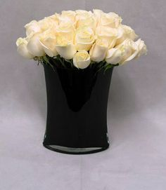Classic white and black arrangements will always be chic and sophisticated. #NYC #style