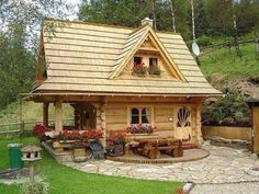 Little log house with a stone patio