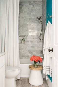 The brightest room in the home color-wise, the attractive terrace suite bathroom offers a simple space to take a shower or bath with aqua walls that provide a punch of personality.