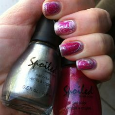 Painted nails with silver (Spoiled S070 Daddy's Credit Card) and put a drop of hot pink (Spoiled S014 Club Rat) in the middle. Swirl with a toothpick.