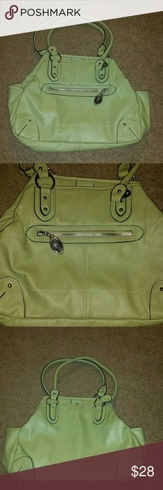 Rosetti bag!! This is in EXCELLENT condition, only flaw is a mark on the bottom! Never tried cleaning! Absolutely spacious!! This will definitely keep you organized! **As always I'm open to offers and I bundle UNDER 5lbs (if I upgrade the label, I get charged the ENTIRE shipping costs as well as you, posh DOUBLE DIPS) NO TRADES! I'm smoke free, pug friendly! I typically ship same or next day! Rosetti Bags Shoulder Bags