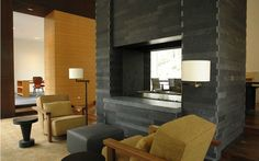 Dovetail joints of slate (?) fireplace... gorgeous.  Vail House by James Dayton Design