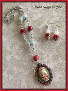 A Sweet Owl Cameo is painted and mounted onto a Silverware Bezel .. Red Rhinestones surround the cameo .. Beautiful Cherry Red and Light Green glass beads and silver plated chain complete this beauty .. Matching Earrings .. For Sale $36.00  .. https://www.etsy.com/shop/CleverDesignsbyJann
