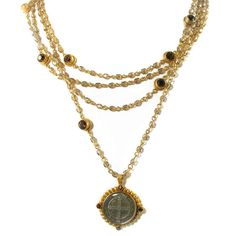 $231 The San Benito Magdalena necklace by Virgins, Saints and Angels is a multi-layered piece shown here in gold with smoky topaz crystals.