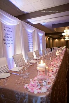 love the candles across the front of the table with the flower petals!