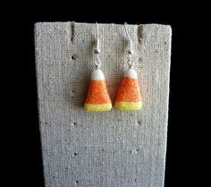 Be prepard for Halloween with these sparkly candy corn earrings! You can choose between silver or gold findings.  Candy CornHalloween CandyHalloween by AllSoCharming on Etsy