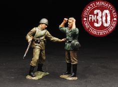 World War II Russian Army EFR-016 Russian Soldier Taking German Prisoner - Made by Figarti Military Miniatures and Models. Factory made, hand assembled, painted and boxed in a padded decorative box. Excellent gift for the enthusiast.