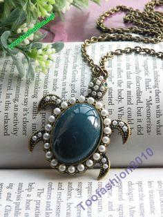 Pretty retro copper blue sea turtle tortoise necklace pendant vintage style. $3.89, via Etsy.
